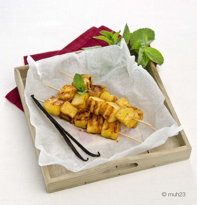 skewers of pineapple with vanilla